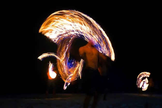Fire performance show dancers swing fire dancing show on the beach at koh samet, thailand