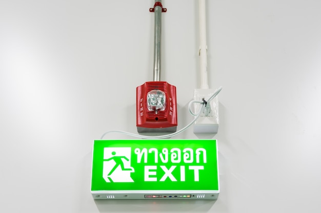 Fire protection alarm and emergency exit sign in modern offices inside an industrial plant