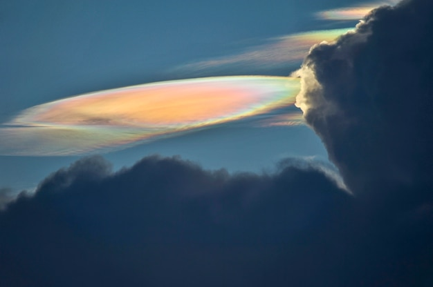Fire rainbow cloud phenomenon is a natural phenomenon called irisation or iridescence.