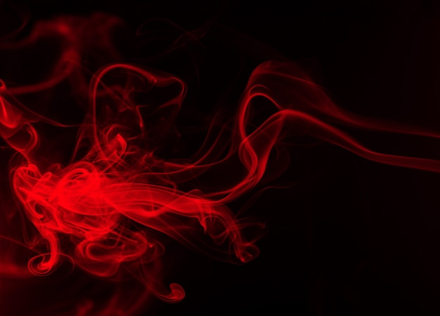 Fire of red smoke abstract on black background, darkness concept
