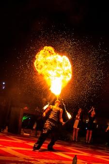 Fire show. fire dancer dances with.
