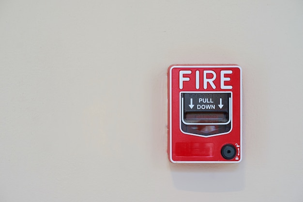 Fire or smoke alarm switch on wall