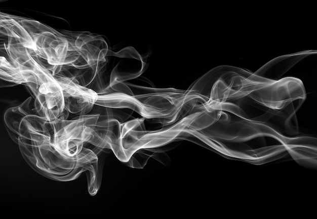 Fire of white smoke on black background. abstract movement