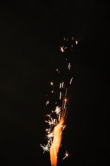 Fire with sparks on black background