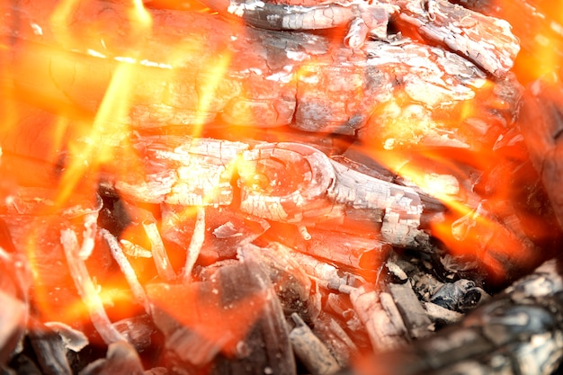 Fire; yellow flames of a wood fire against black background