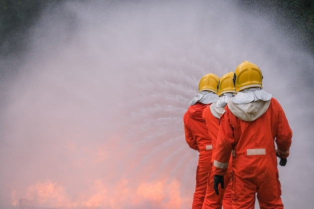 Firefighter are using water in fire fighting operation