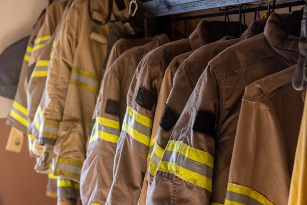 Firefighter's uniforms and gear arranged at fire station