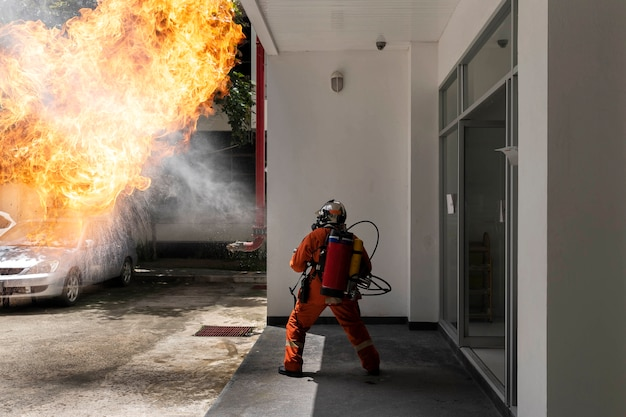 Firefighter with backpack fire extinguishing gun. emergency fire rescue.