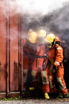 Firefighters rescue colleague from building with smoke
