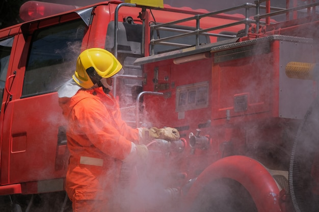Firefighters training, team practice to fighting with fire in emergency situation