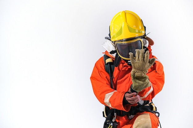 Firefighters wearing firefighting clothing on a white background and helps to prevent fire