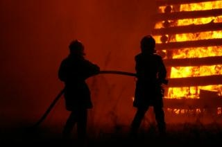 Firemen at work, blaze