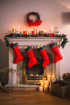 Fireplace decorated with christmas motifs and red socks