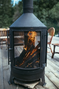 Fireplace stove with burning wood in the street