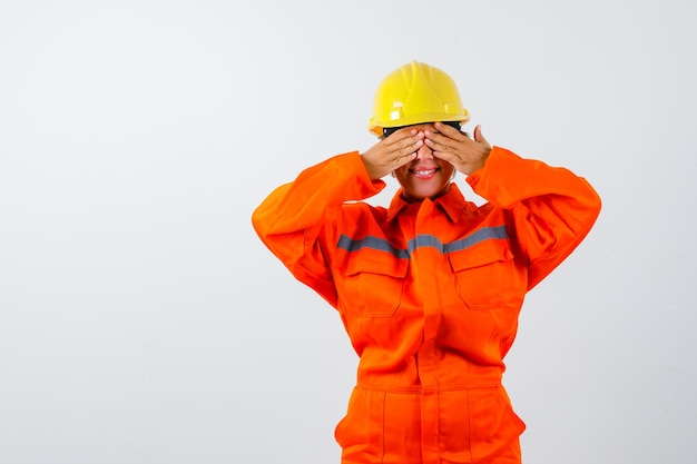 Firewoman in her uniform with a safety helmet