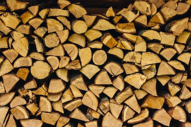 薪の山が一緒に積み上げテクスチャ背景