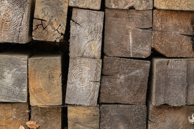 Firewood stacked in a woodpile. aged timber.