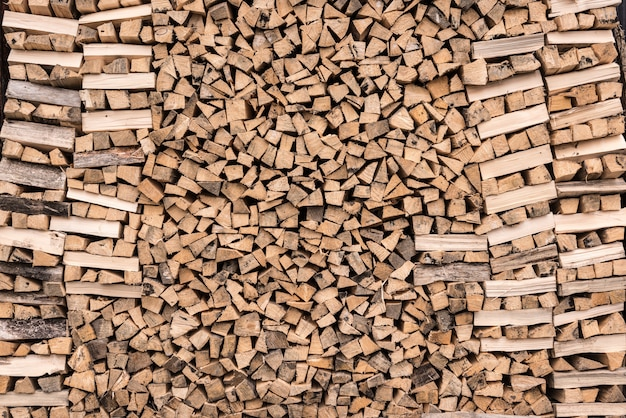 Firewood stock background. background of dry chopped firewood.