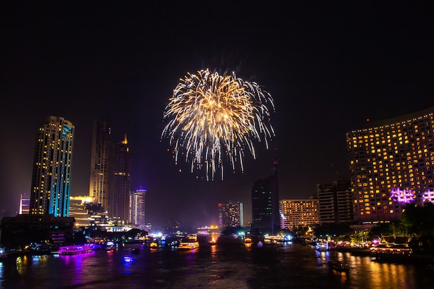 Firework colorful on night city view background for celebration festival.
