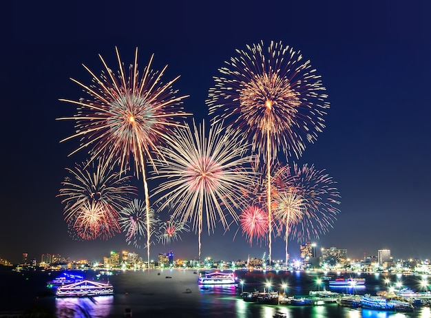 Fireworks over cityscape by the beach