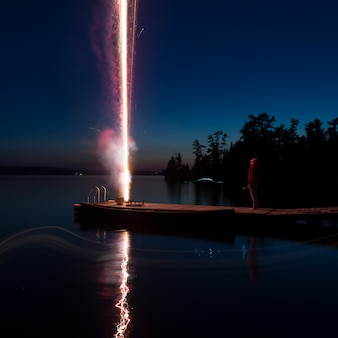 Fireworks on dock, lake of the woods, ontario, canada