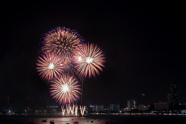 Fireworks explored over cityscape at night in pattaya international fireworks festival