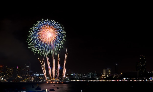 Fireworks explored over cityscape at night in sea port in pattaya.