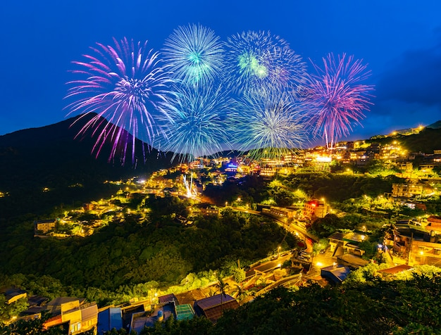 Fireworks over jiufen old street city at night, taiwan