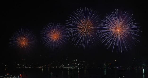 Fireworks over lake during festival.