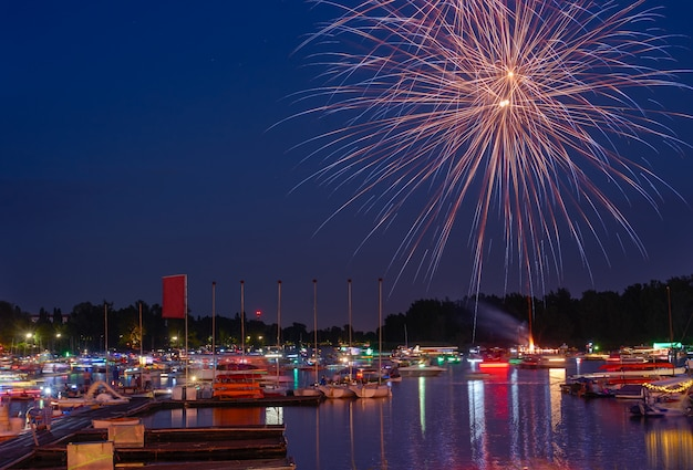Fireworks of summer holiday in a city.