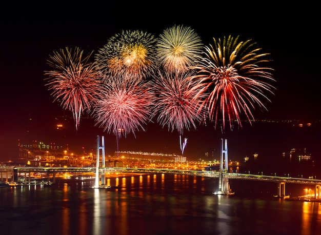 Fireworks over yokohama bay bridge  at night, japan
