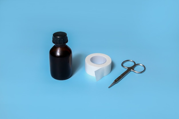 First aid for cuts and injuries to fingers, knees. antiseptic, adhesive plaster, scissors.