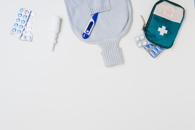 First aid kit and medical equipment on white
