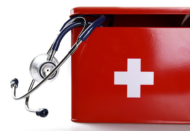 First aid kit with stethoscope - isolated image