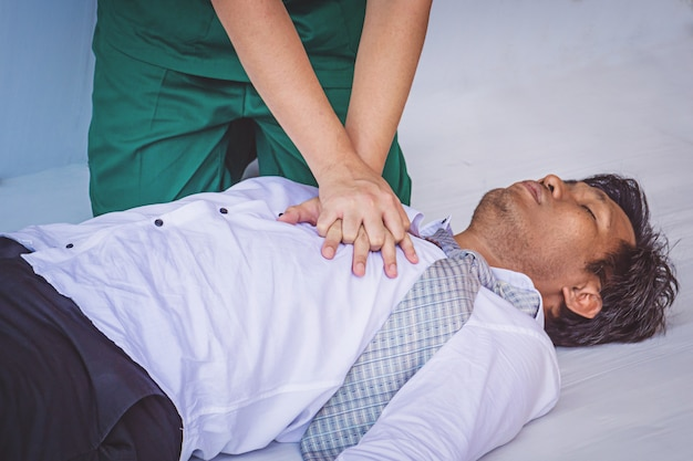 First aids emergency cpr on heart attack man