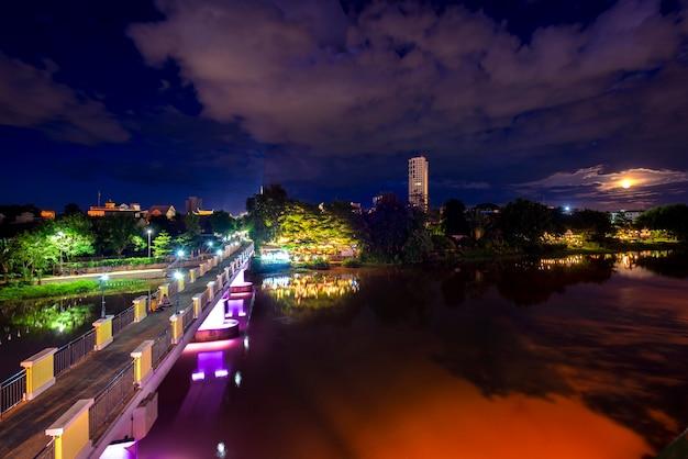 The first bridge of chiang mai (jansom bridge) is near warorot market view image landscape of twhite light  focus