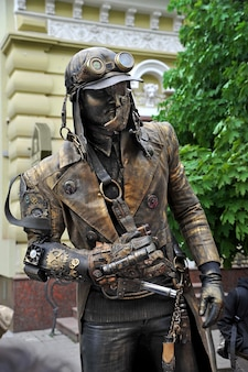 First festival of living statues steampunk style man with various mechanical devices