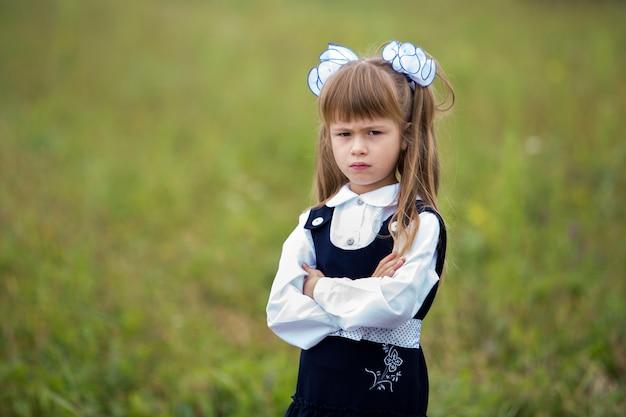 First grader girl in school uniform.