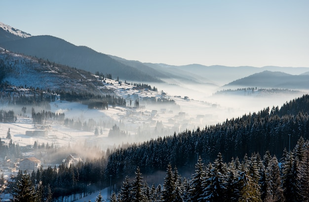 First shadows of setting sun on winter ski resort carpathians