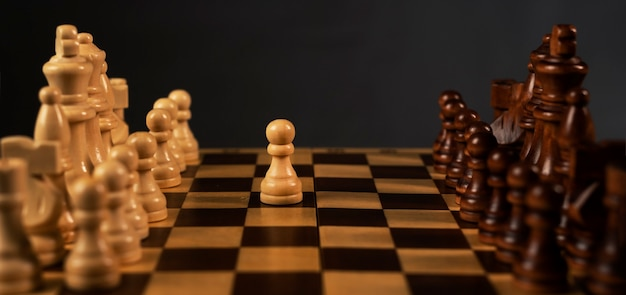 First step of white pawn on chess chessboard