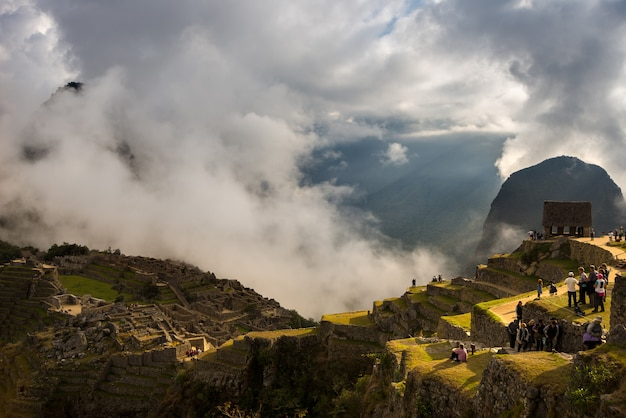 First sunlight on machu picchu from opening clouds