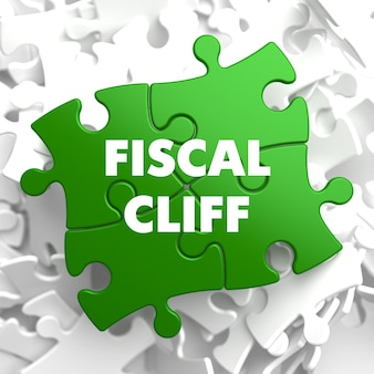Fiscal cliff on green puzzle on white.