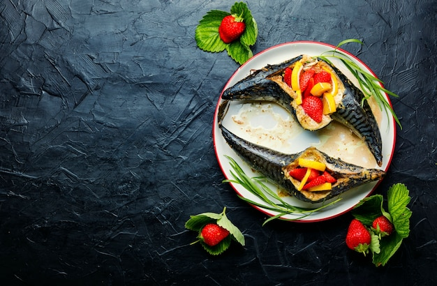 Fish baked with berries and lemon.summer fish dish,baked mackerel.space for text