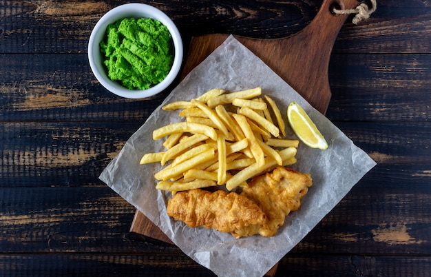 Fish and chips on a wooden background. british fast food. recipes. snack to beer. english cuisine.