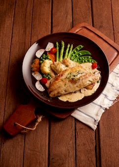 Fish dish, fried fish fillet and vegetables