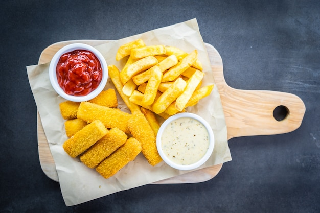 Fish finger and french fries or chips with tomato ketchup
