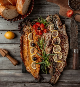 Fish grilled and served with lemon and rosemary