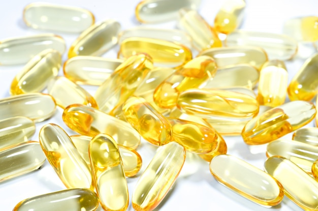 Fish oil capsule on isolated white.