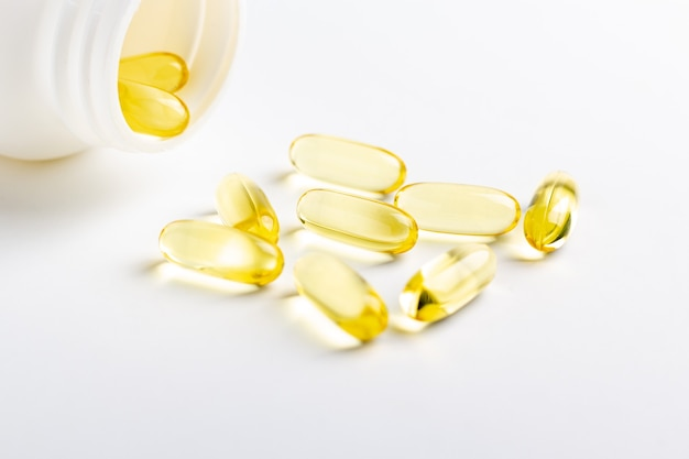 Fish oil capsules and bottle isolated on white background