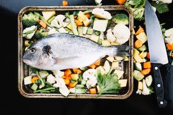 Fish on vegetables